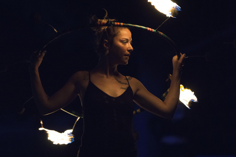 woman fire dancing during night