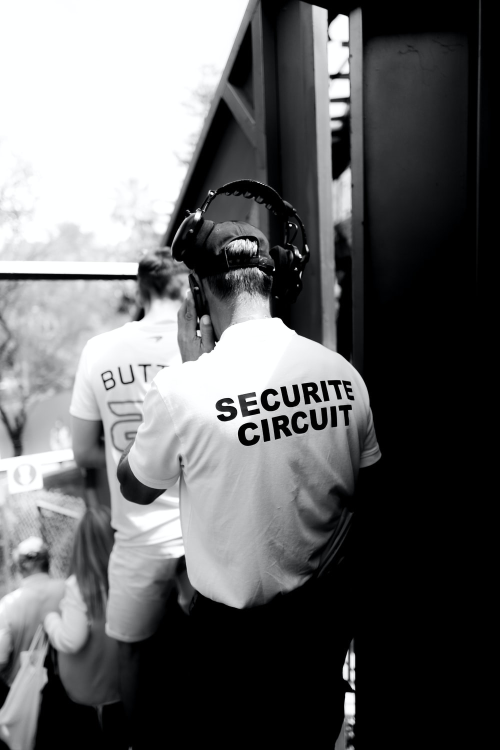 security personnel with headphones grayscale photo