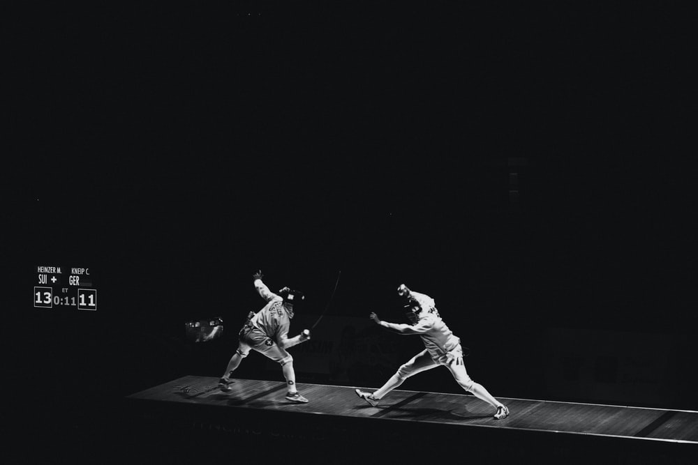 two people fencing