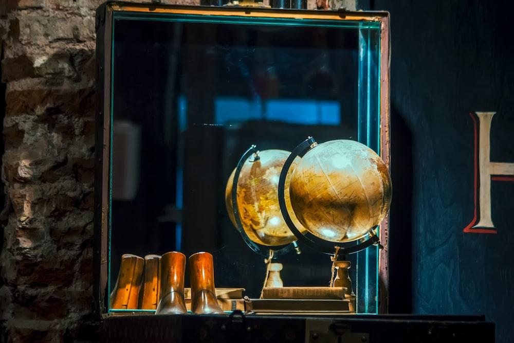 beige desk globe front of mirror