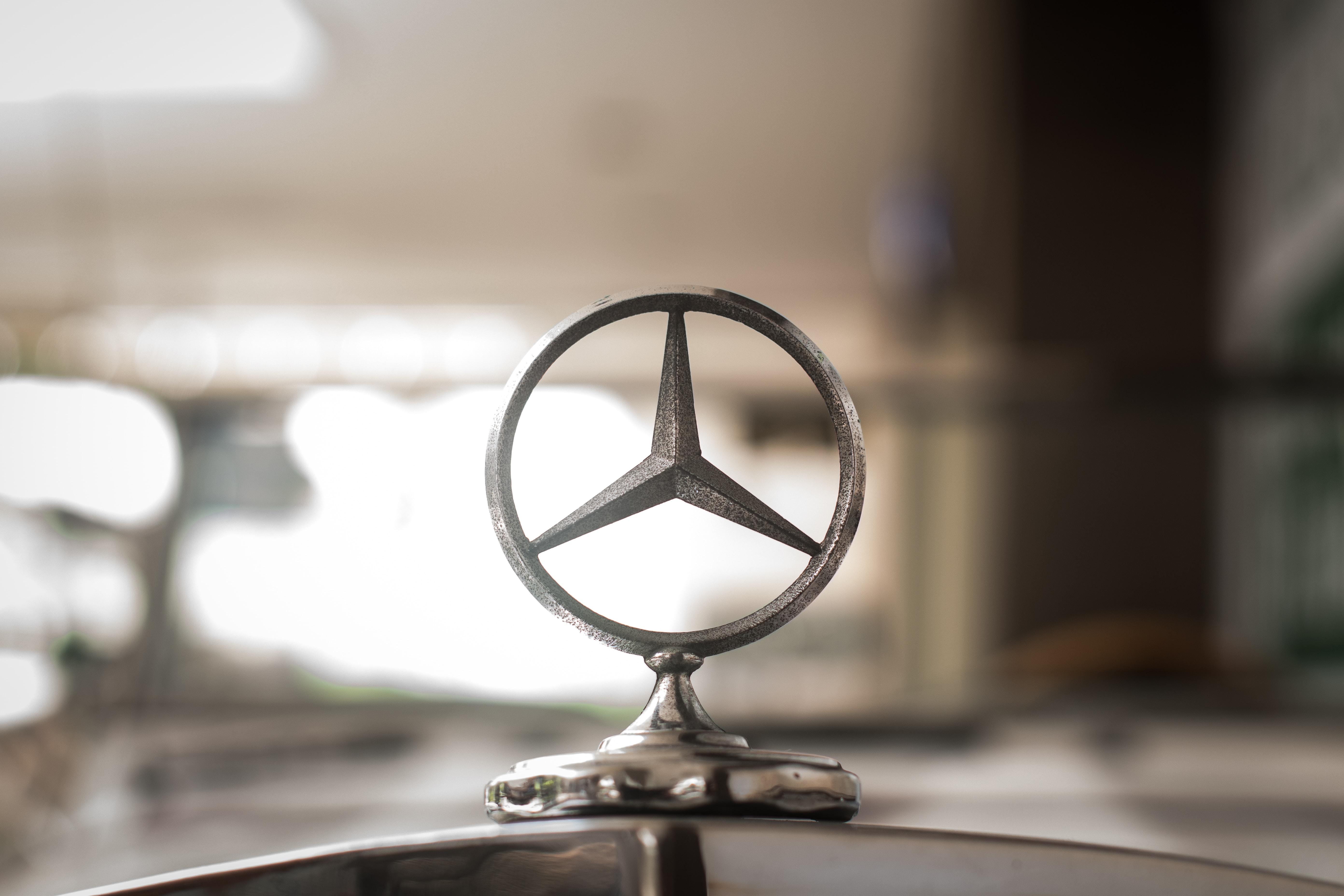 gray Mercedes-Benz hood ornament