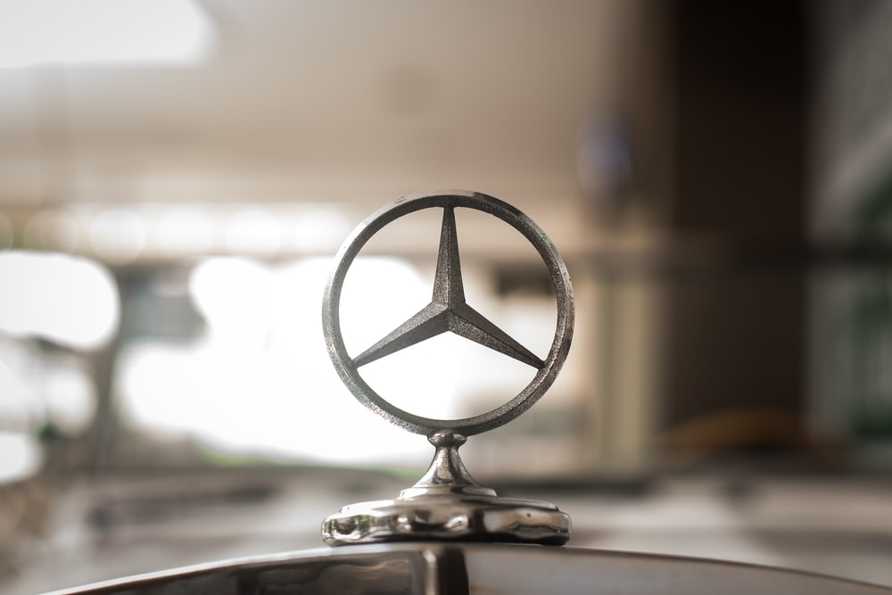 gray Mercedes-Benz hood ornament