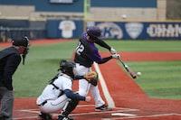 baseball player swinging bat