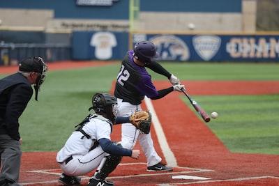 baseball player swinging bat baseball teams background