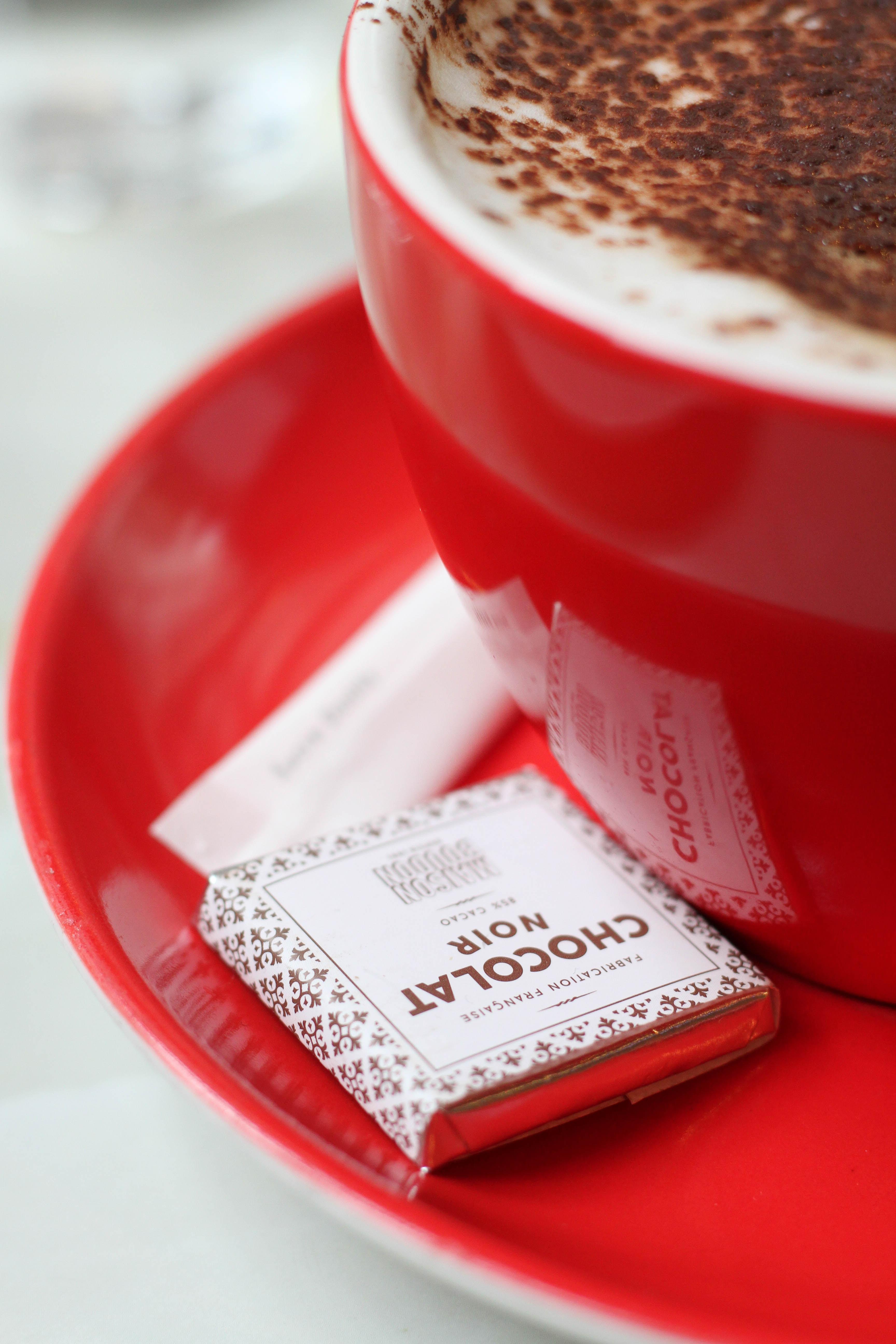 red ceramic mug with suacer