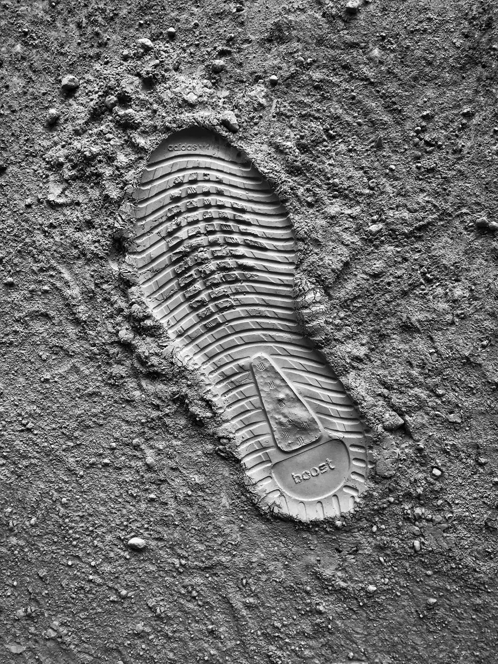 grayscale photo of sneaker sole print