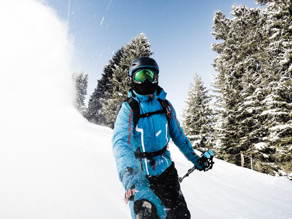 person snow skiing while taking a selfie