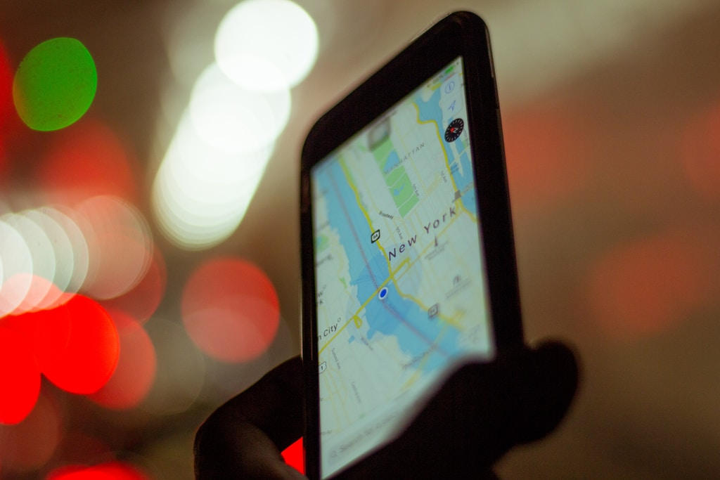 person holding smartphone displaying GPS