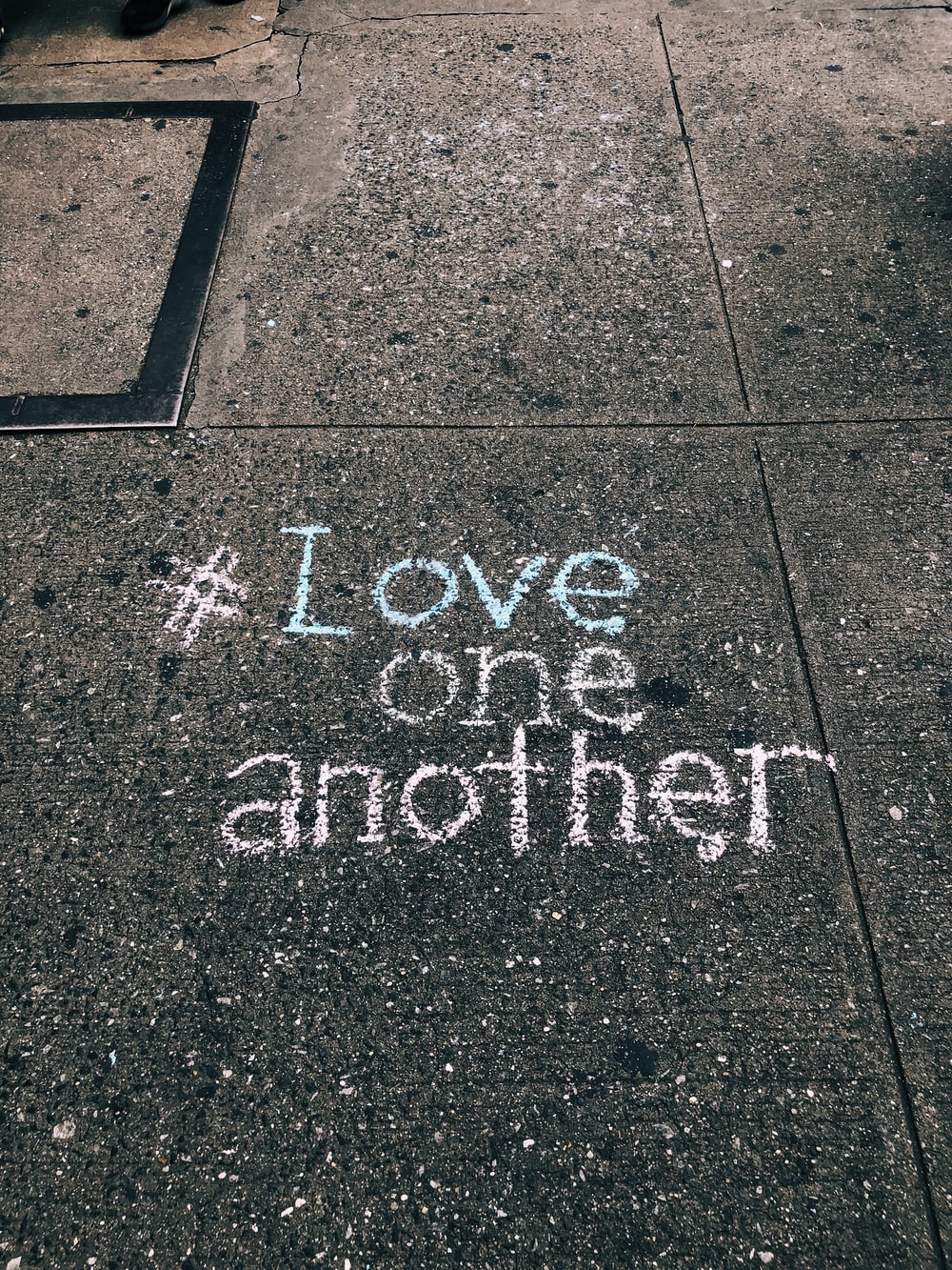 #love one another chalk written on concrete floor, apologise and make up