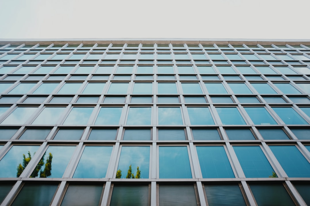 I captured this picture of a government building in Portland, OR. The cerulean reflection on its glass and steel panels caught my eye.