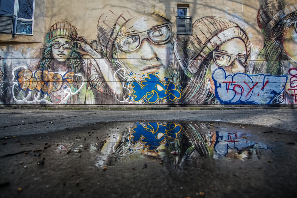 graffiti of person wearing hat and eyeglasses