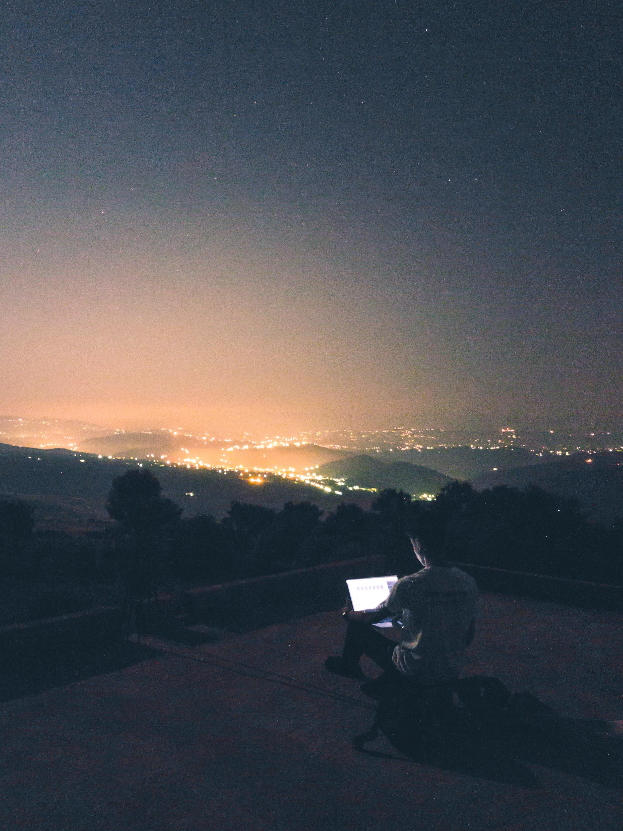 photo of man staring on laptop