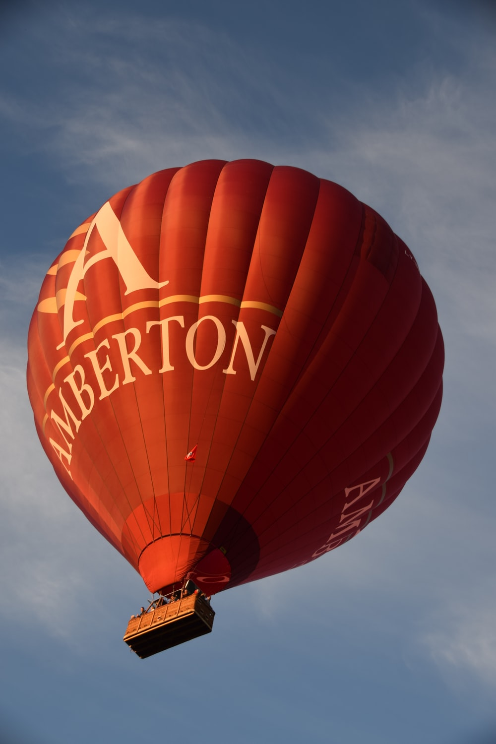 low angle photo of red Amberton hot air balloon