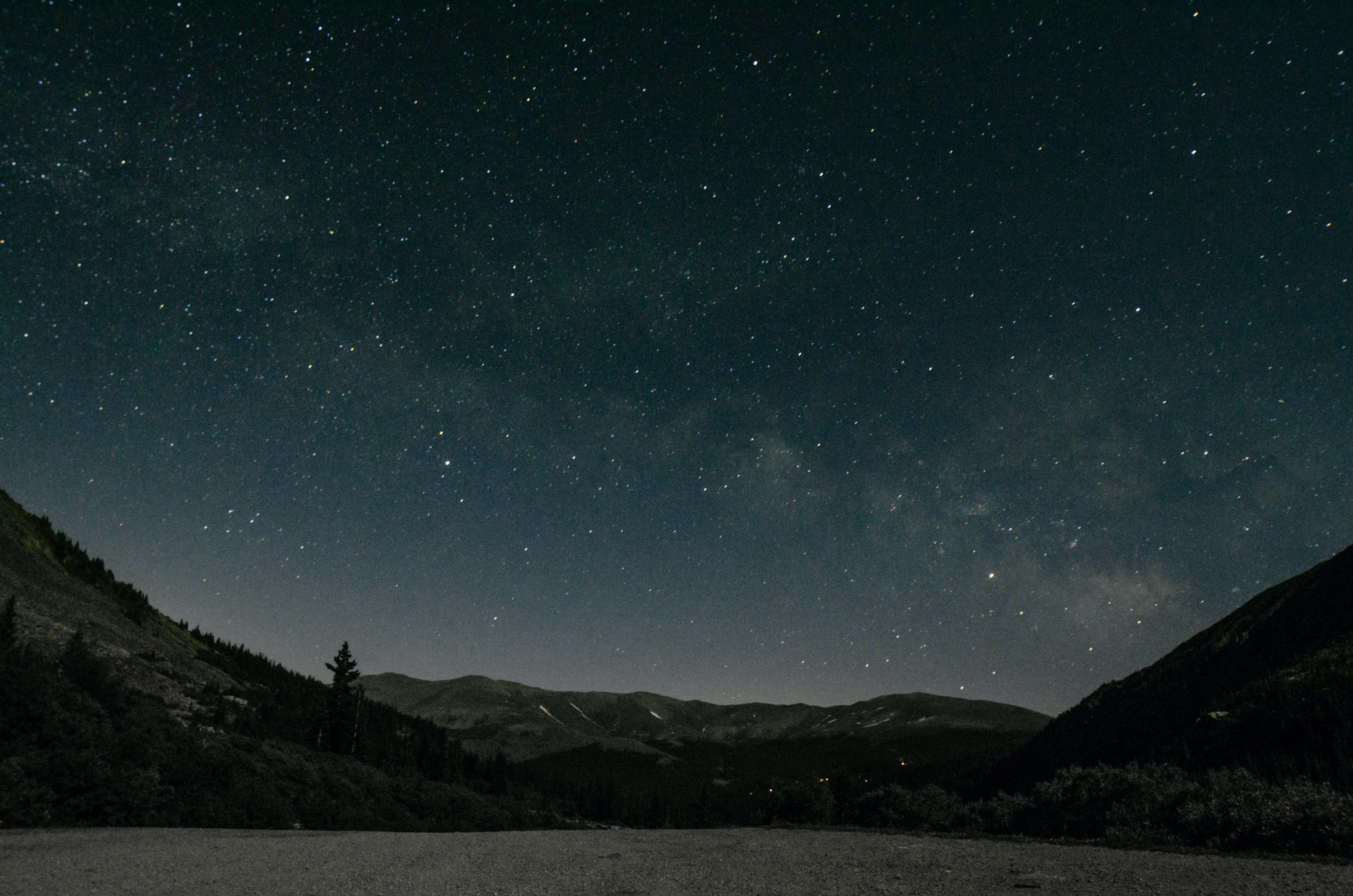 landscape photography of mountain ranges under starry sky