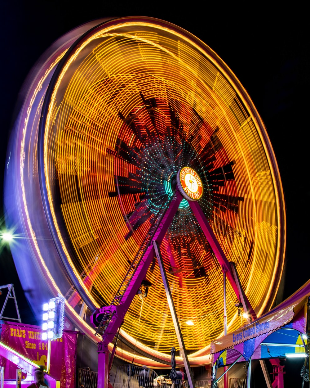 yellow and pink Ferris wheel