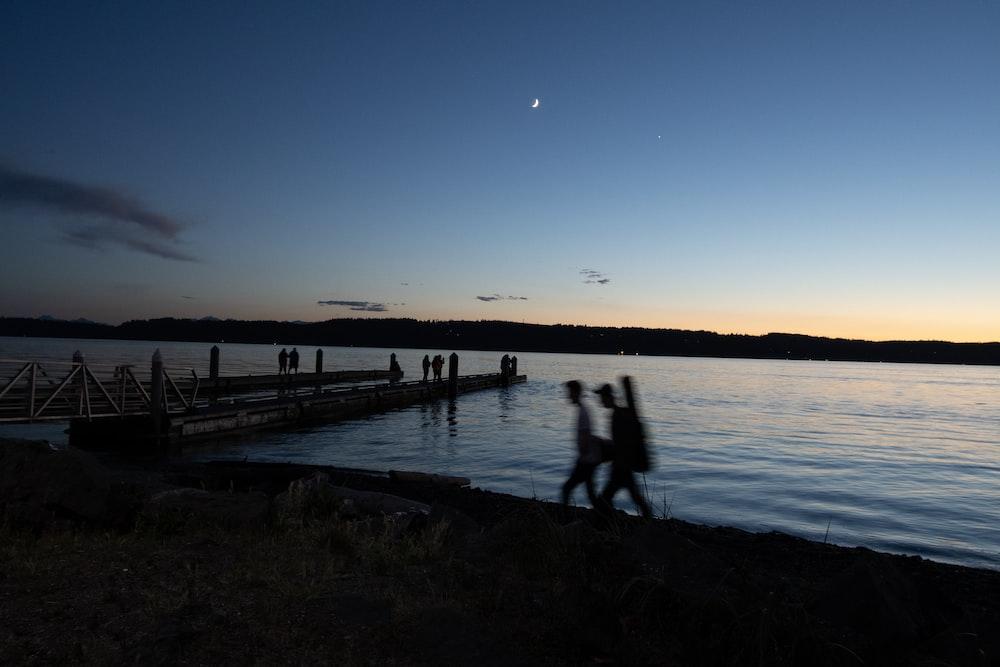 people walking on dock during daytime