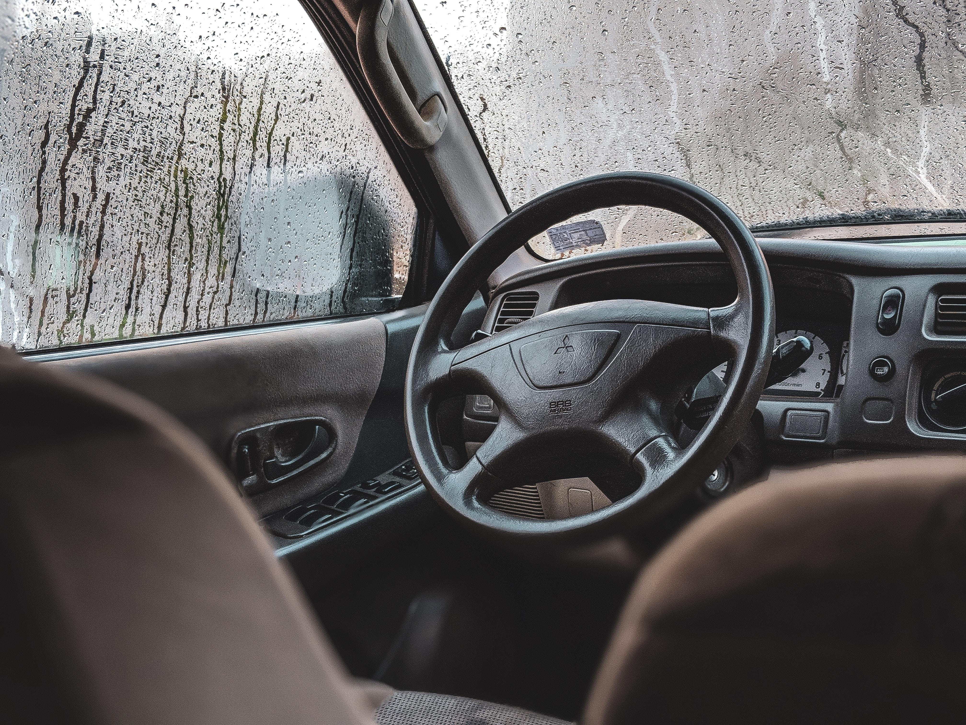 black Mitsubishi vehicle steering wheel