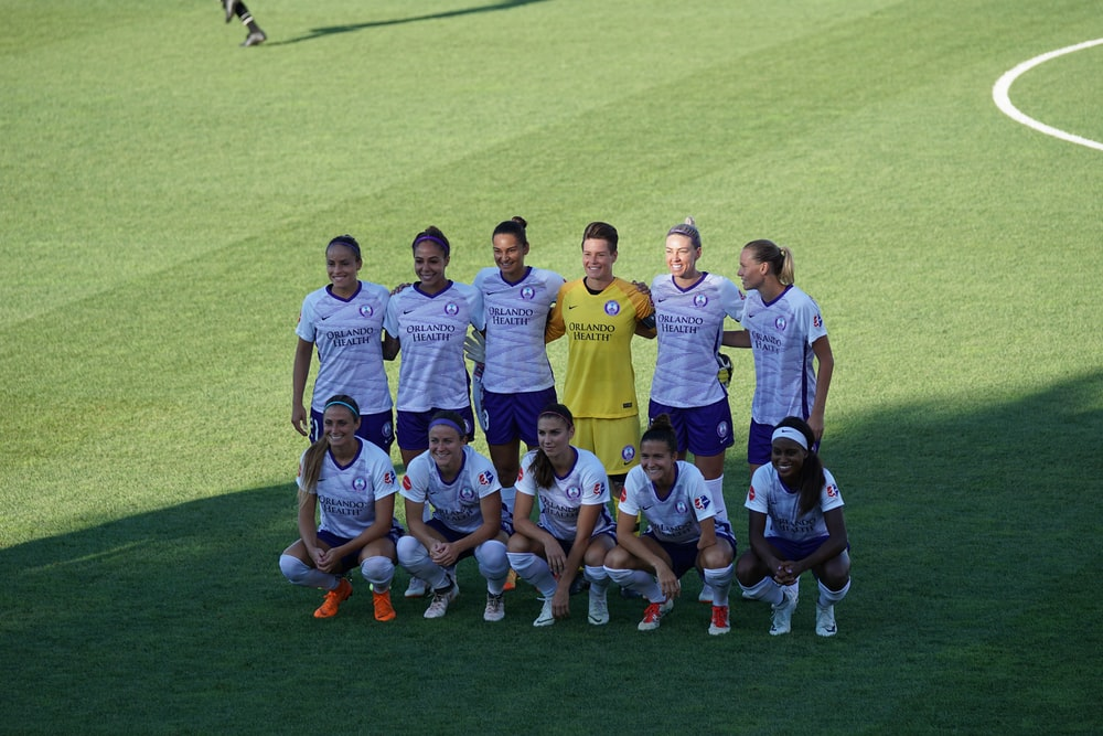 female soccer players taking photo