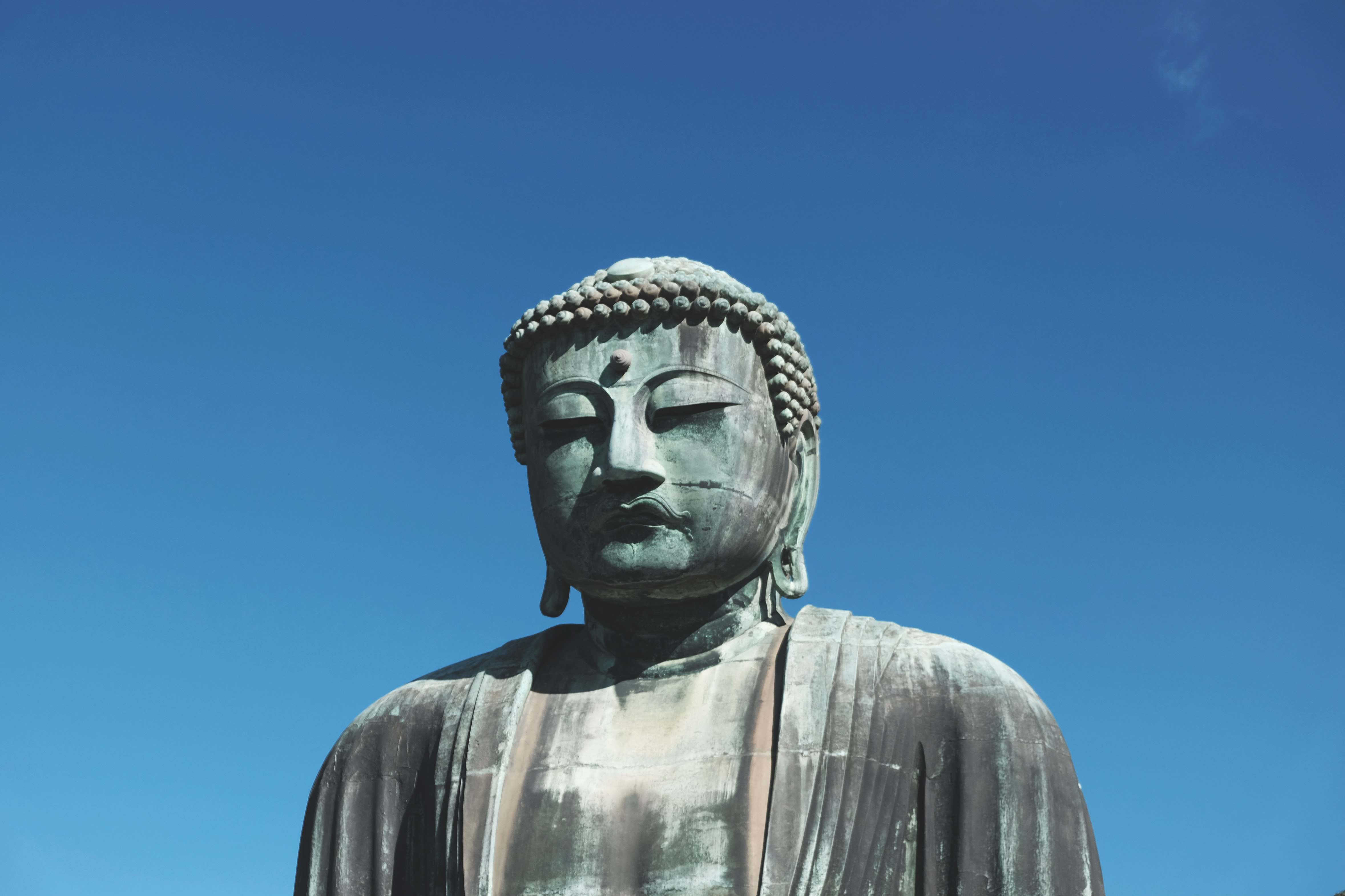 Gautama Buddha statue under clear blue sky