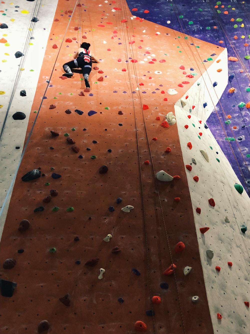 person wall climbing