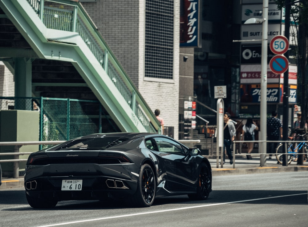 black sports coupe near staircase