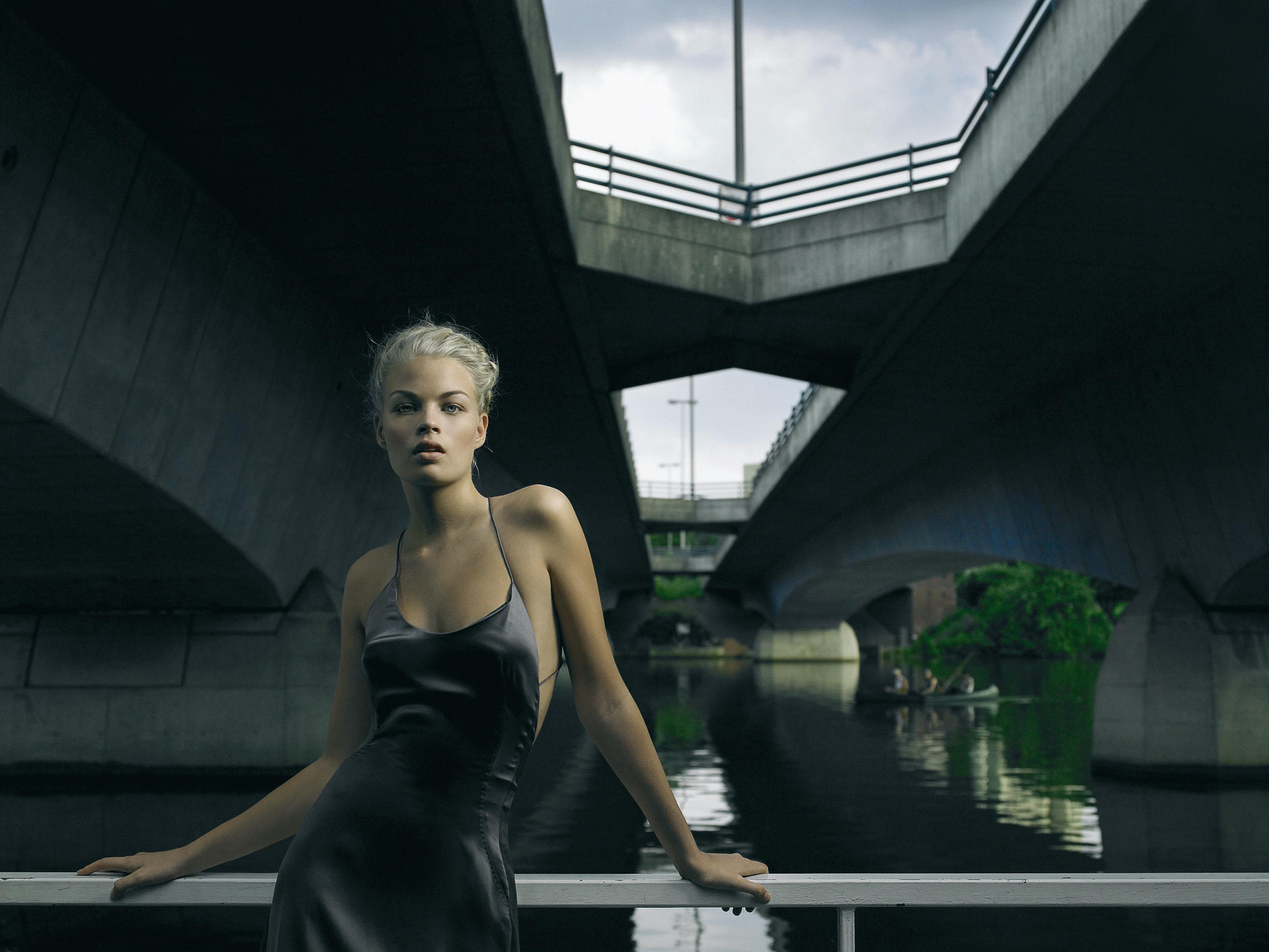 woman wearing gray satin tank dress