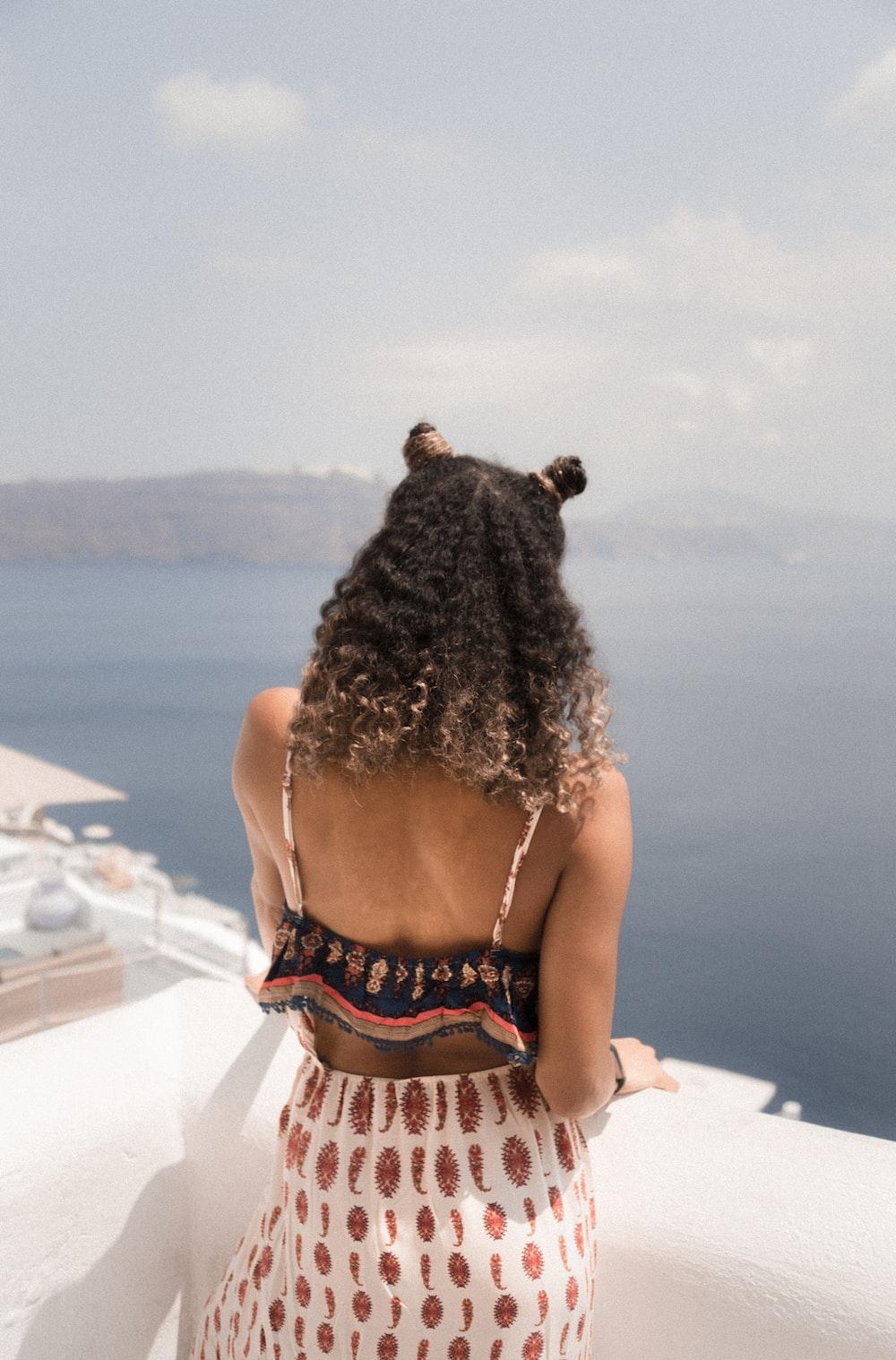 woman standing on balcony