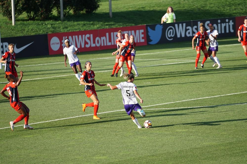 girls playing soccer on ball field