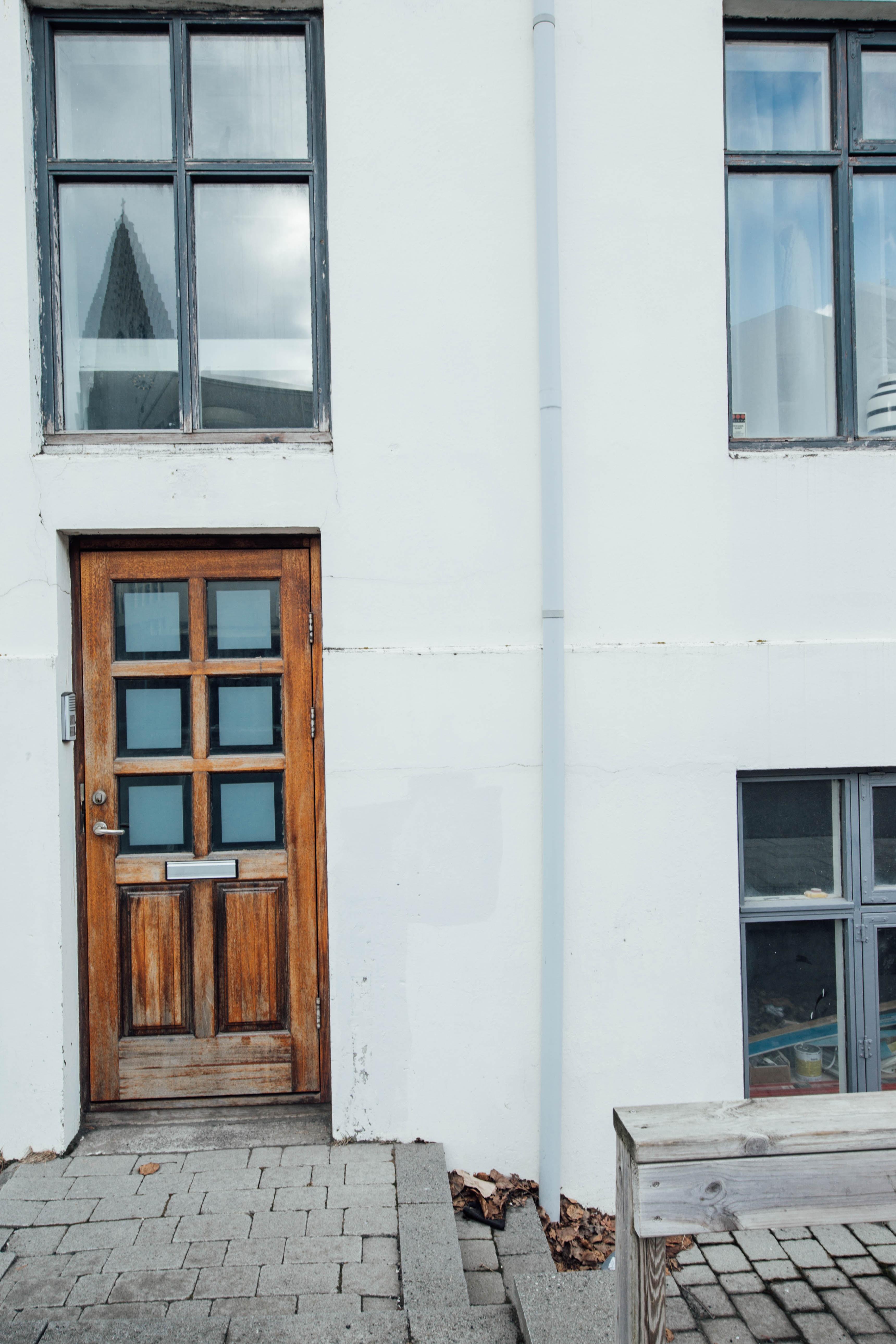 brown wooden door board on white building