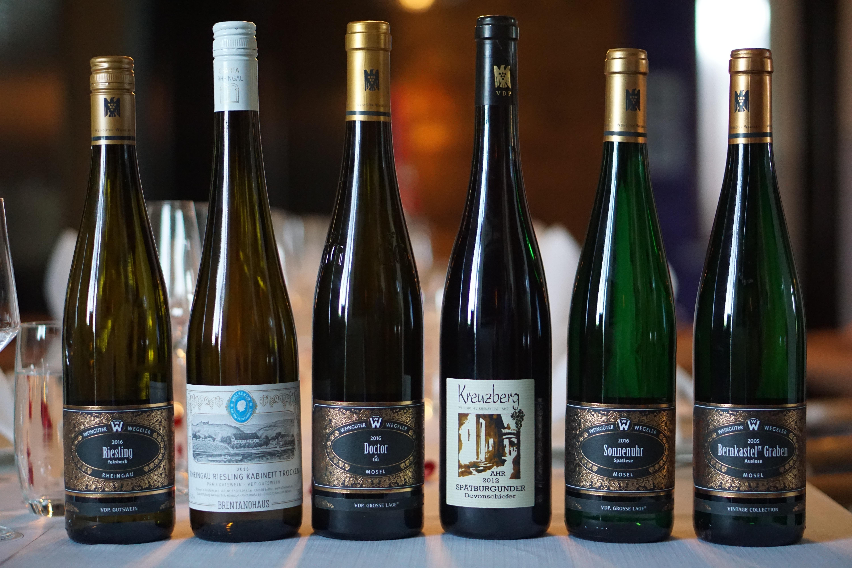 six assorted-color glass liquor bottles