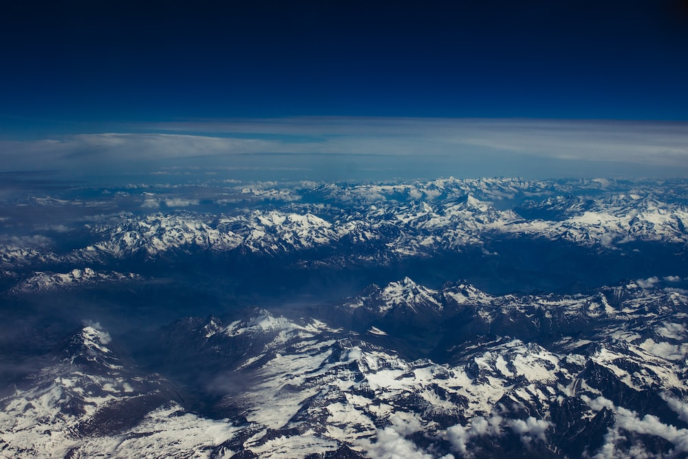 aerial photography of ice covered mountains during daytime