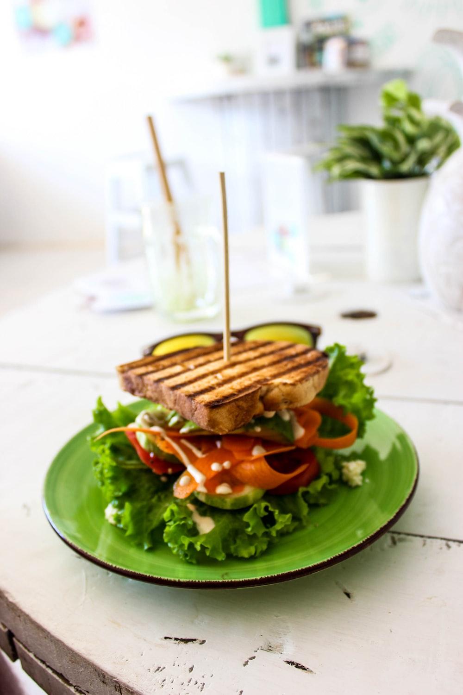 skewered sandwich on green plate