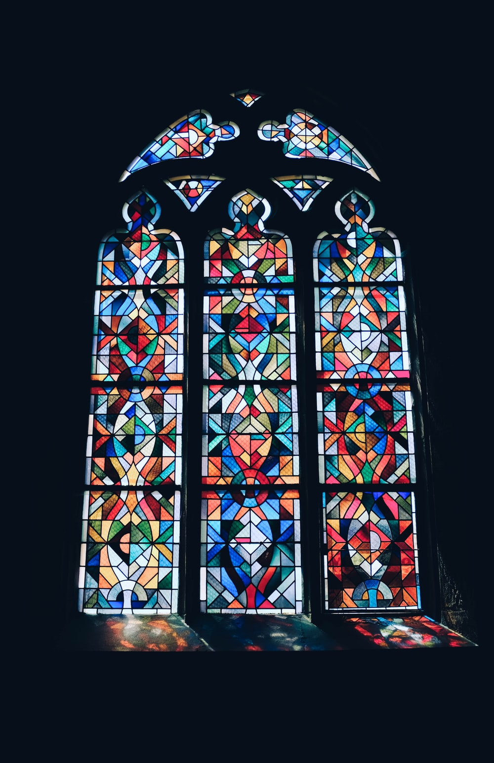 photo of multicolored glass mosaic windowpane