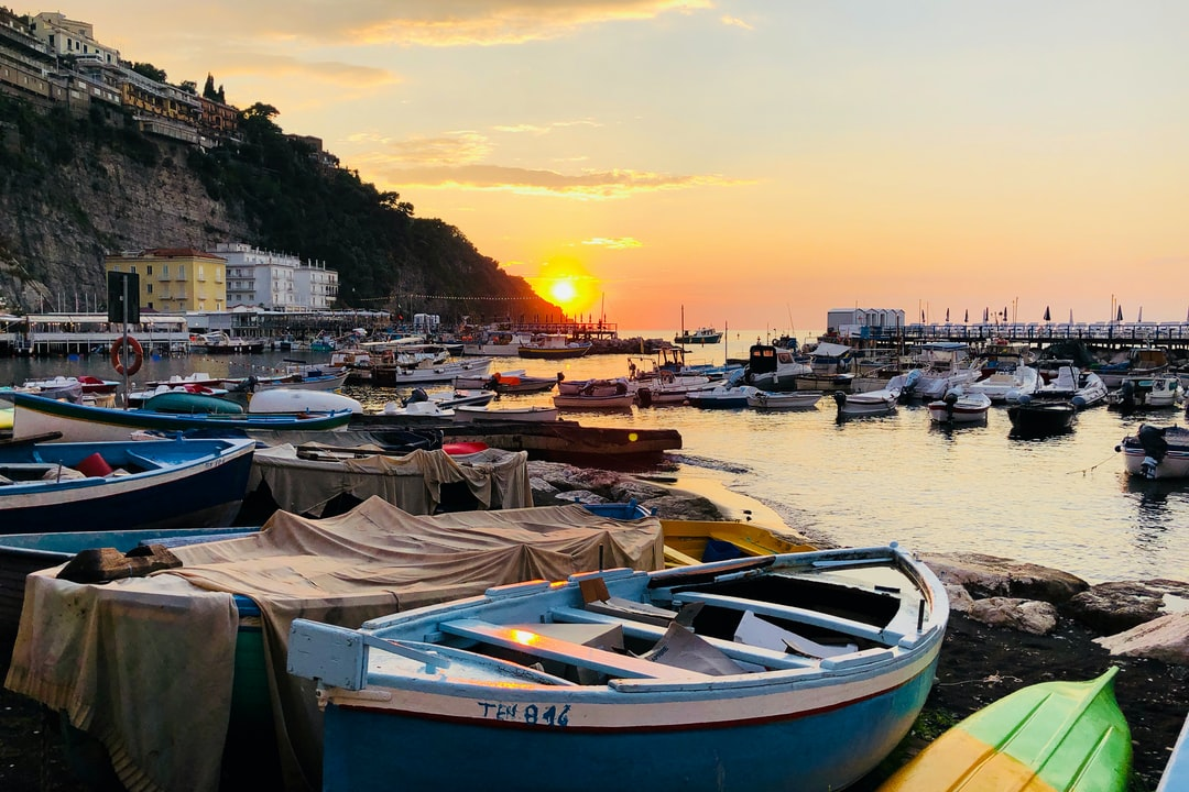 This is the Grand Marina of Sorrento, Italy.  It is the main fishing harbour.  This was taken from one of the many fish restaurants that line the harbour.  The restaurants serve the freshest of fish, caught that day by the local fishermen.  What better way to watch the sunset, whilst eating a freshly caught sea bream, accompanied by a glass of local Italian white wine.