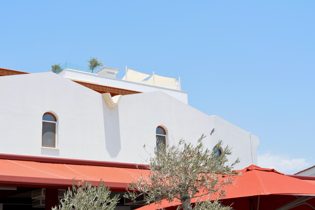 white and orange concrete building at daytime