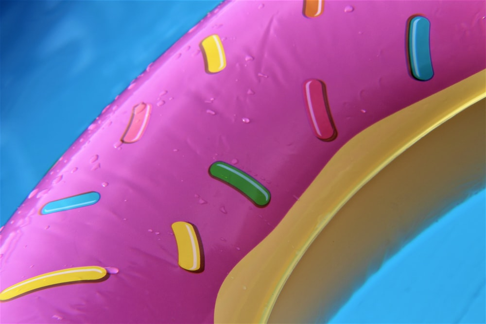 pink and brown doughnut-themed pool floater