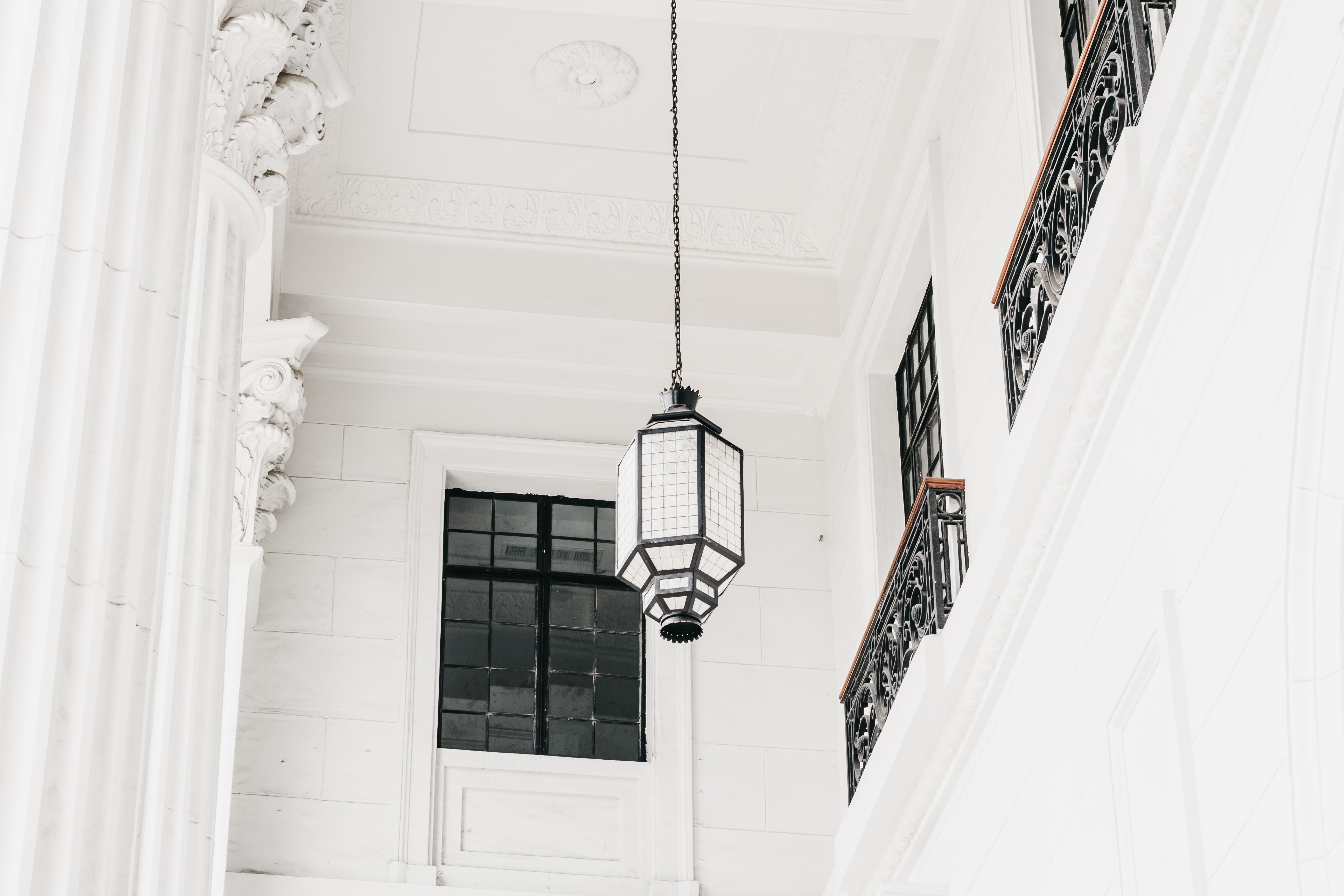 low-angle photo of black and white pendant lamp