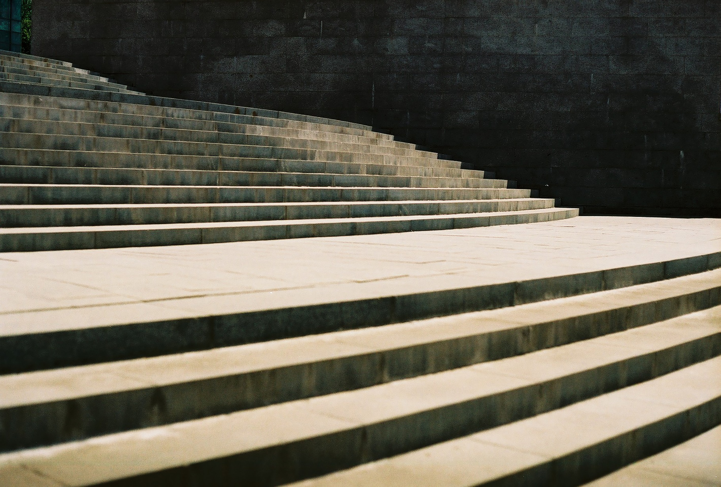 gray concrete stair during daytime