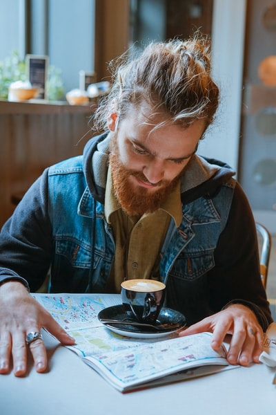 man looking at coffee