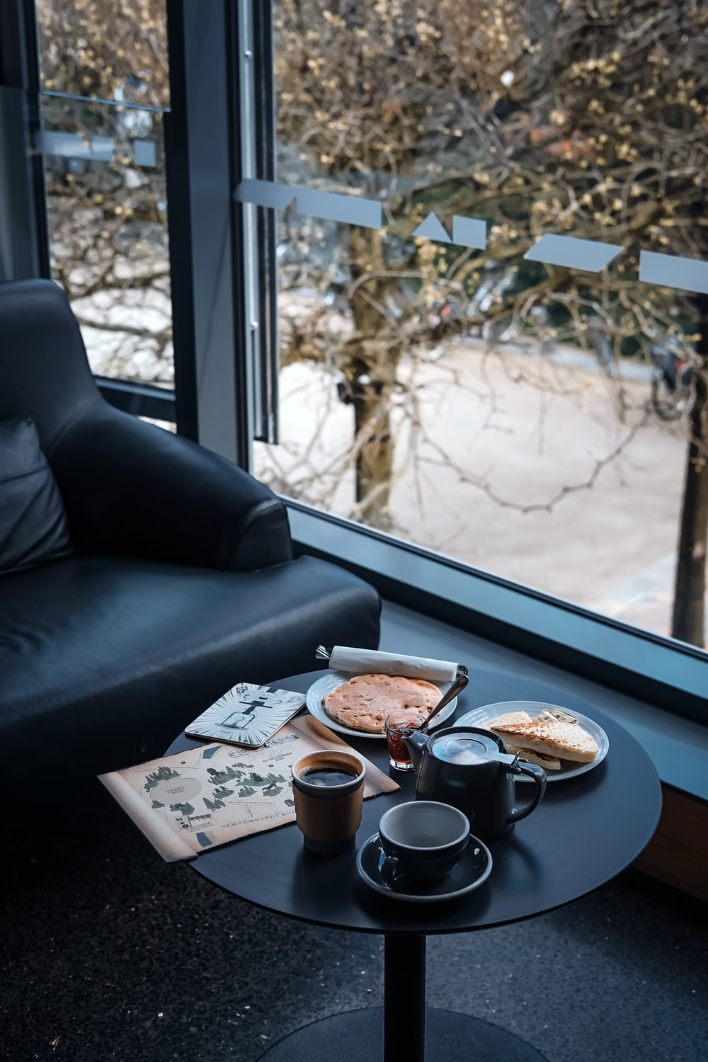 round black side table with coffee cup