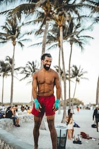 smiling man wearing red shorts during daytime