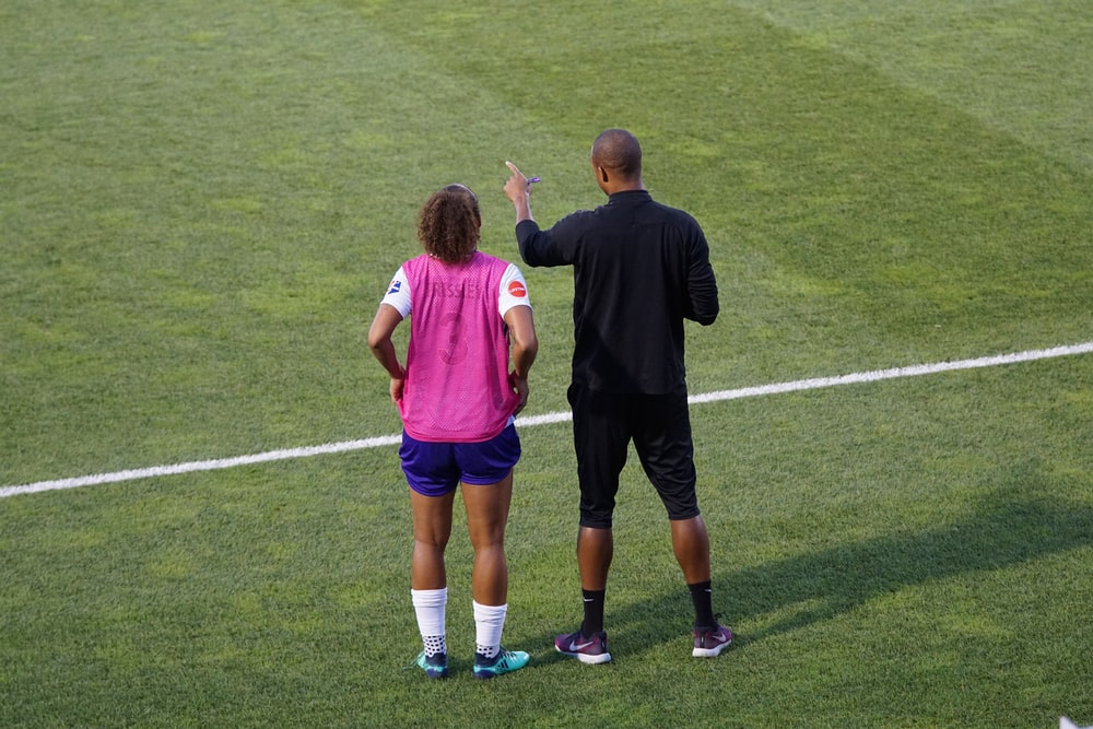 man and woman standing on field