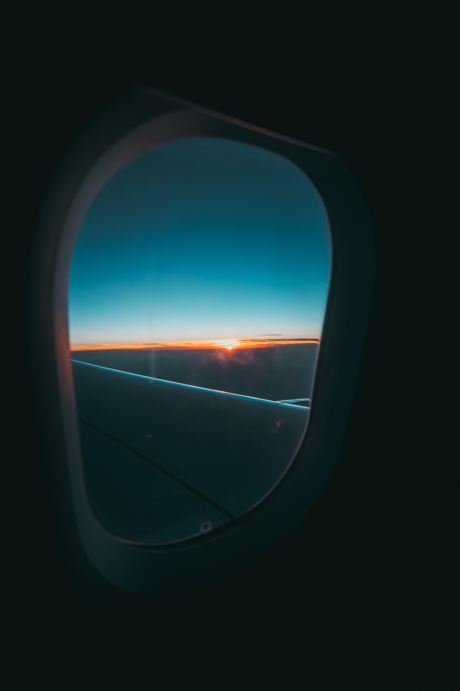 window's plane photography of cloud