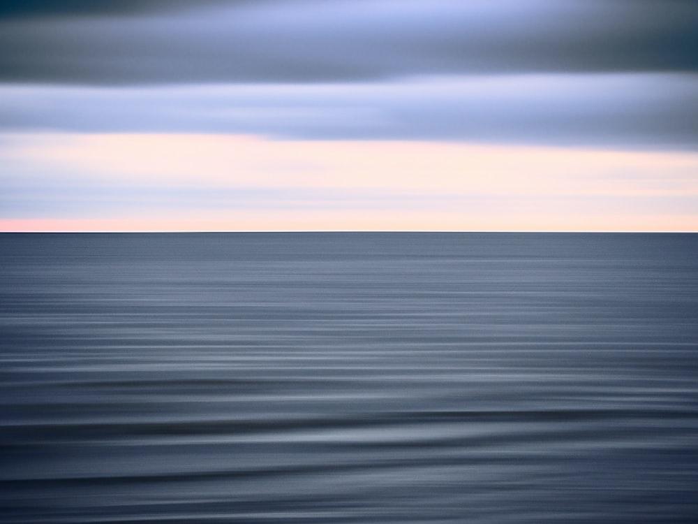 sea water under white sky