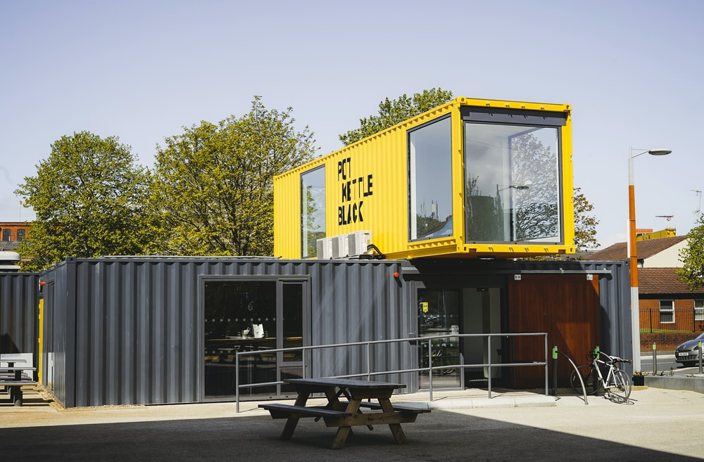 grey and yellow metal container van during daytime