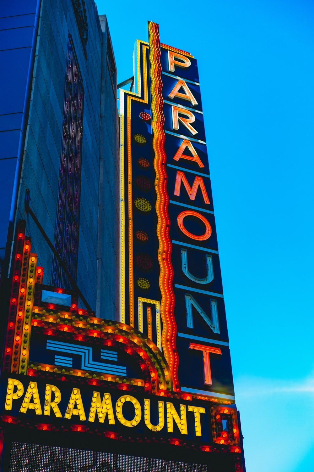 photo of Paramount signboard under clear blue sky