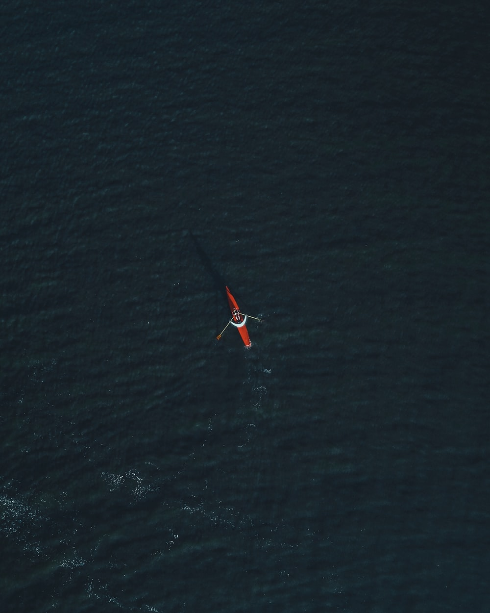 aerial photography of person riding on kayak during daytime