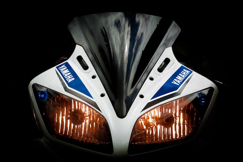 white and blue Yamaha sport bike powered-on headlight