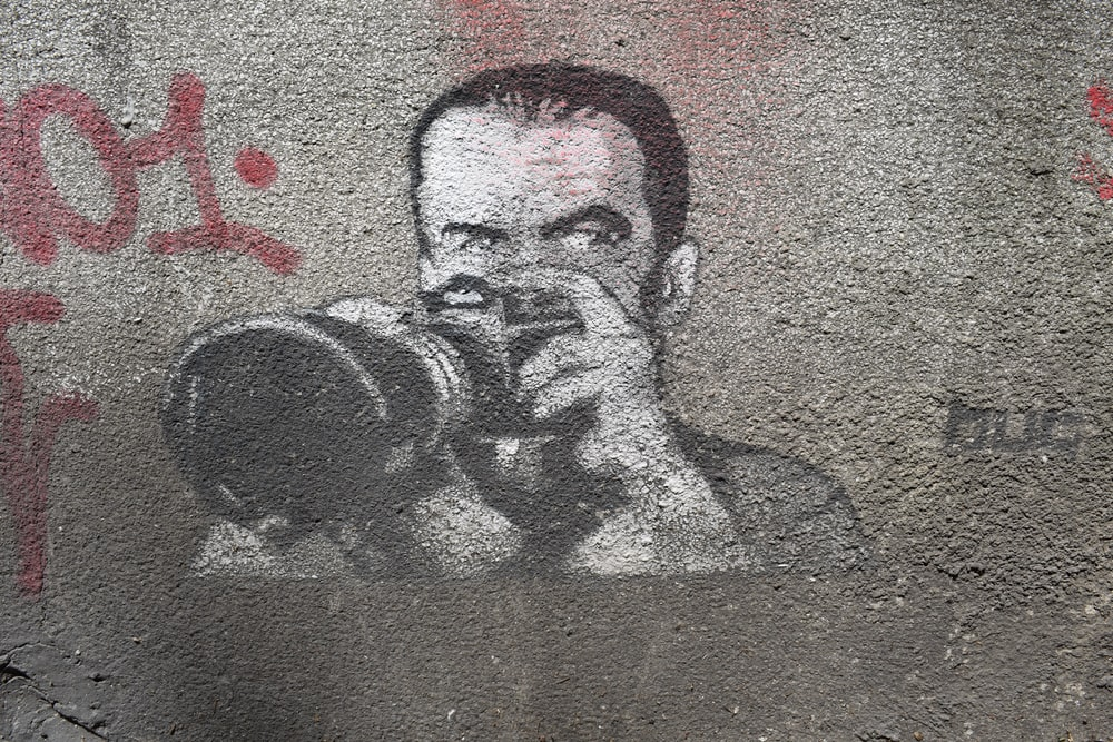 man holding DSLR camera illustration