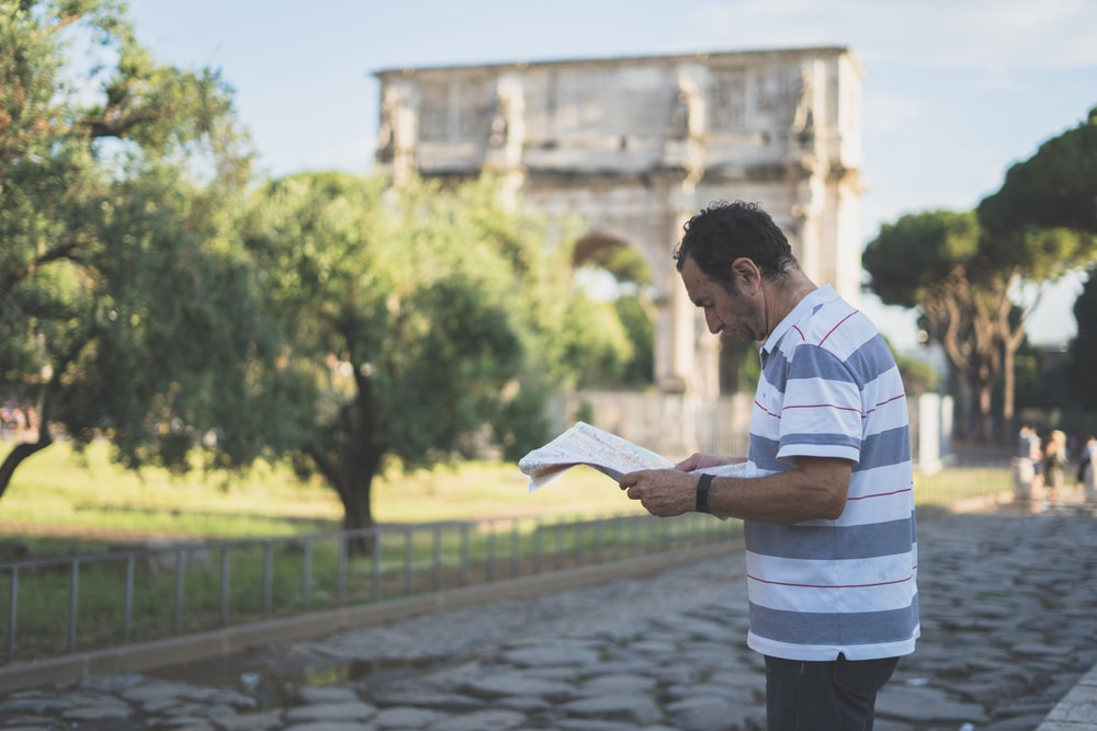 man reading newspaper while standing